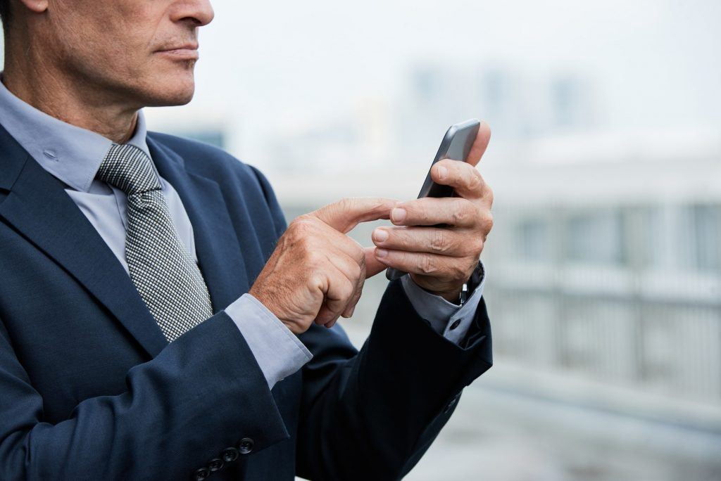 Businessman using mobile app